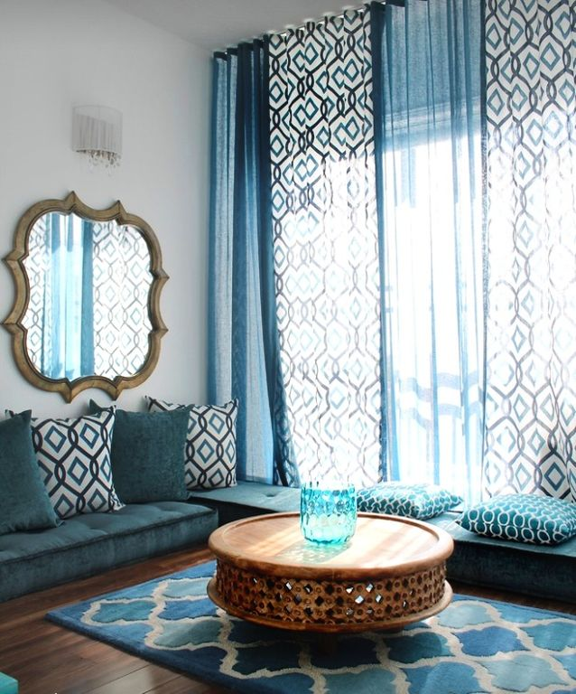 Eclectic Living Room with Window seat, Hardwood floors, Wall sconce, Diamond Ikat Embroidery Pillow Cover, Standard height