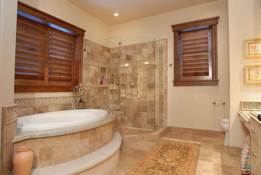 Craftsman Master Bathroom with Hunter douglas newstyle hybrid shutters, partial backsplash, Paint 1, stone tile floors