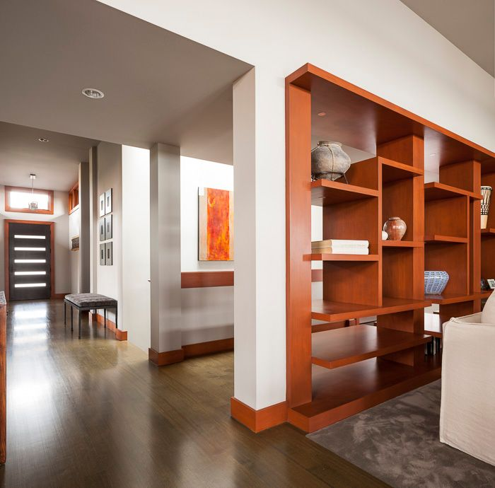 Contemporary Living Room with can lights, High ceiling, Laminate floors, Built-in bookshelf