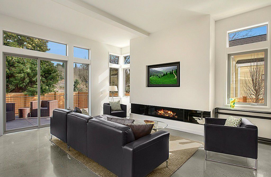 Contemporary Living Room with Standard height, Fireplace, sliding glass door, Casement, picture window, Transom window