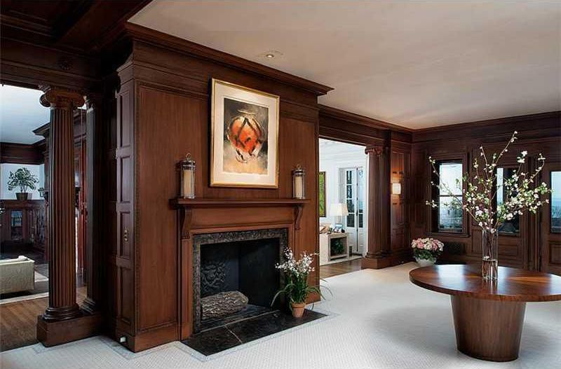 Craftsman Living Room with stone fireplace, can lights, Standard height, Columns, Wall sconce, Crown molding, Fireplace