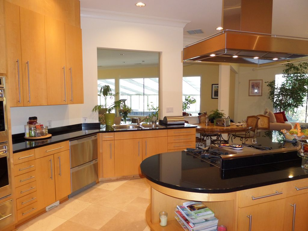 Contemporary Kitchen with Standard height, Soapstone counters, electric cooktop, warming oven, Island Hood, Flush, can lights