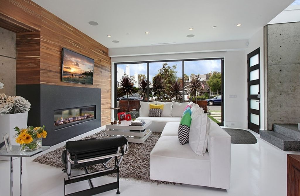 Contemporary Living Room with French doors, Standard height, Concrete floors, can lights, picture window, insert fireplace