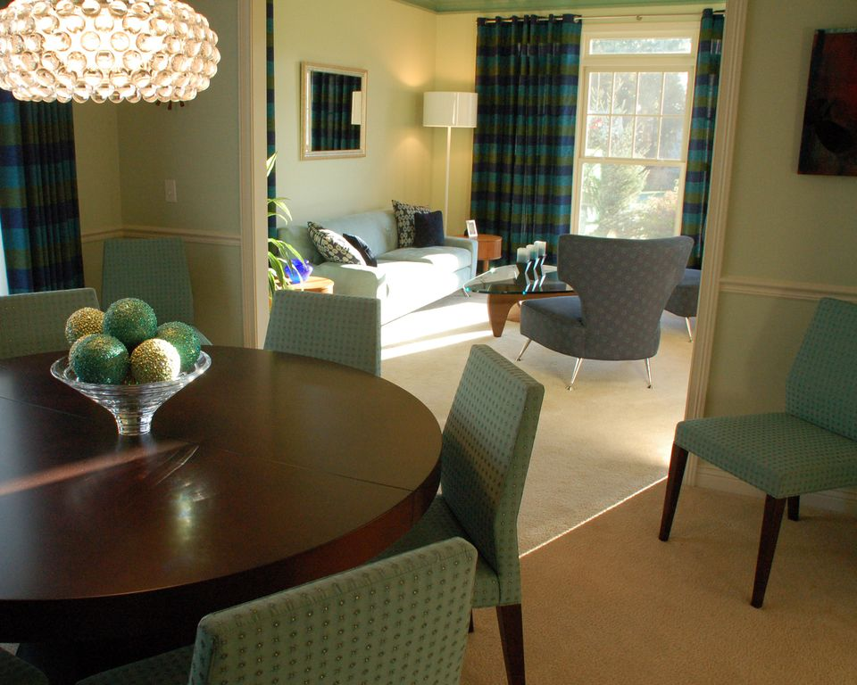 Contemporary Dining Room with Standard height, Pendant light, Chair rail, Ceiling fan, Carpet