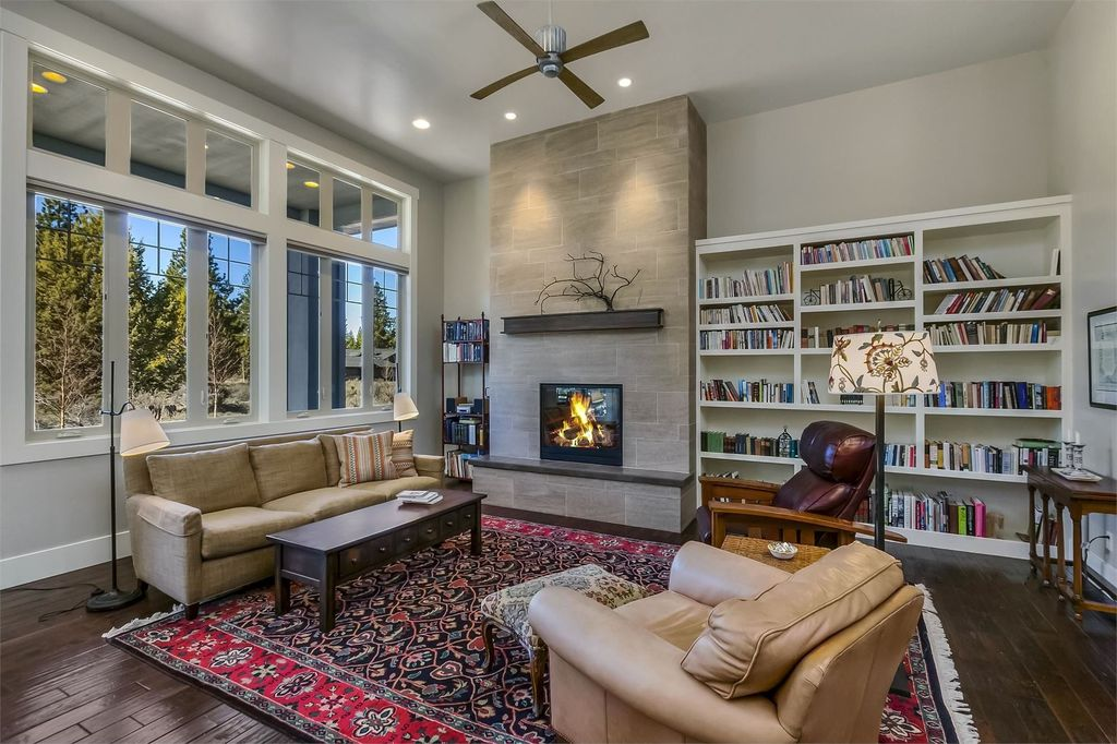 Contemporary Living Room with Casement, picture window, Built-in bookshelf, Hardwood floors, can lights, stone fireplace