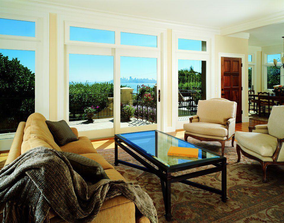 Traditional Living Room with French doors, Hardwood floors, Crown molding, Transom window, six panel door, Standard height