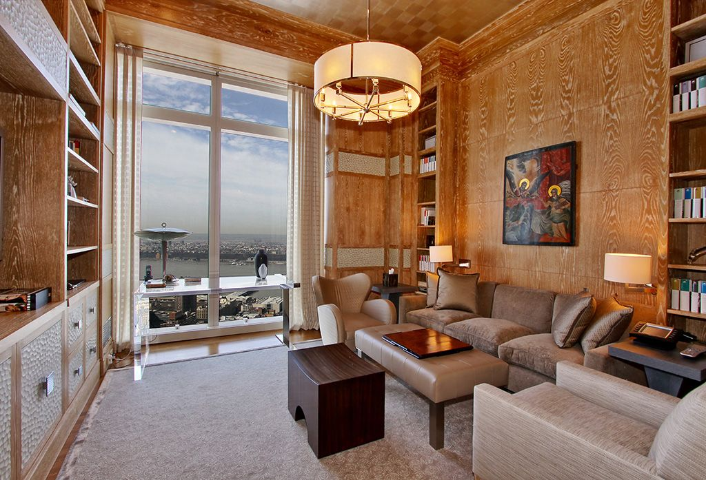 Contemporary Living Room with Hardwood floors, interior wallpaper, Built-in bookshelf, High ceiling, Crown molding