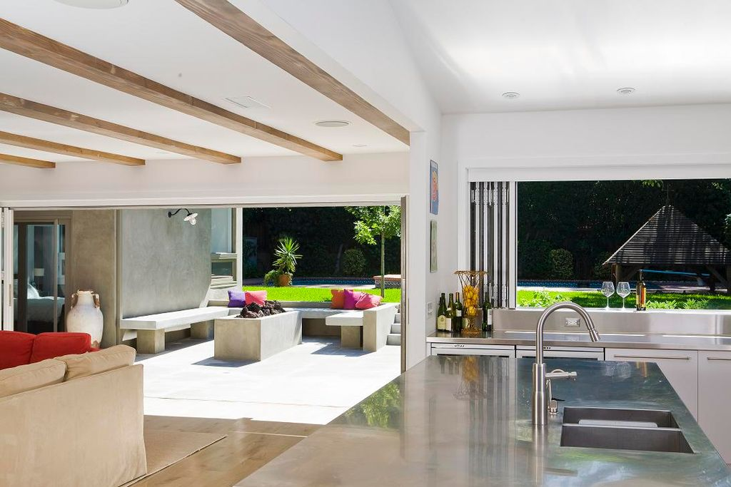 Contemporary Great Room with Concrete floors, Exposed beam