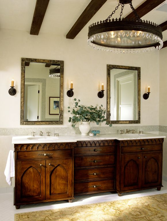 Mediterranean Master Bathroom with Flat panel cabinets, Complex marble counters, Wall sconce, Standard height, specialty door