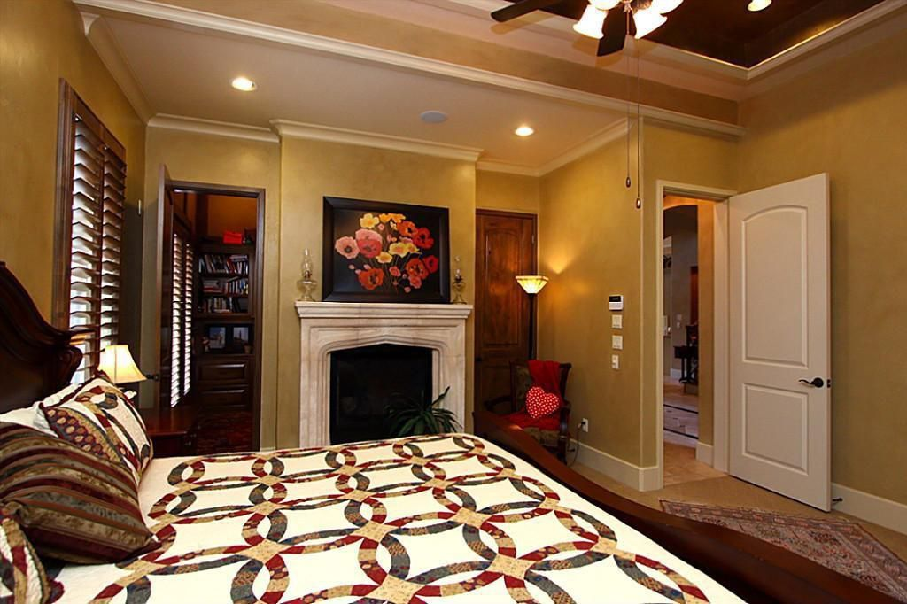 Eclectic Guest Bedroom with Carpet, Cement fireplace, Fireplace, Ceiling fan, Standard height, Wall sconce, six panel door