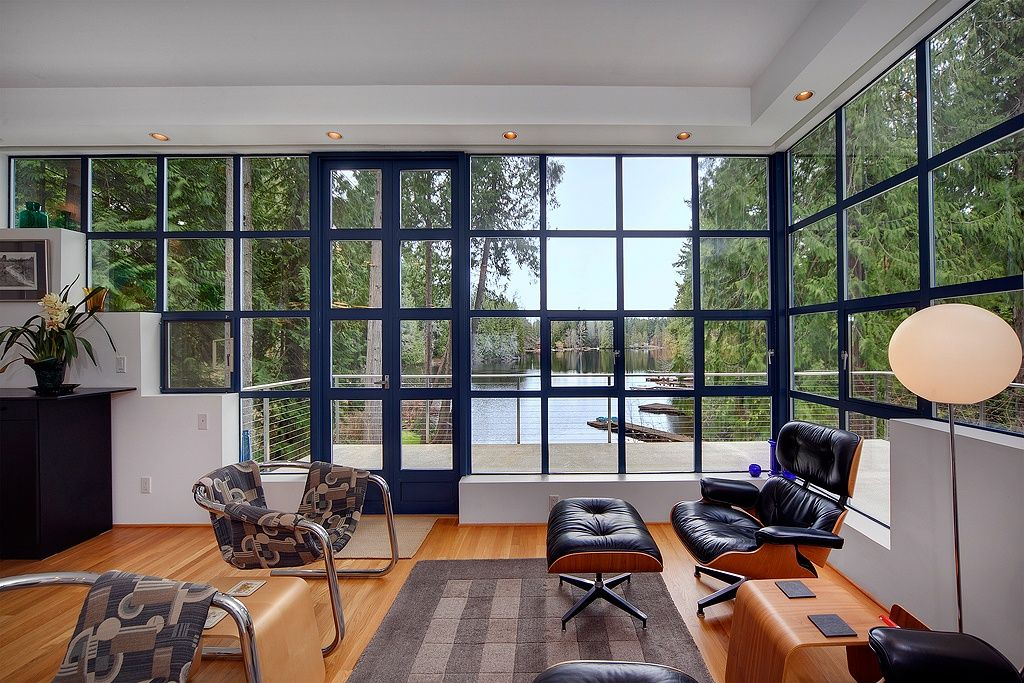 Contemporary Living Room with Eames lounge chair and ottoman, Hardwood floors, Offi Mag Table, Glo-Ball F3 Floor Lamp