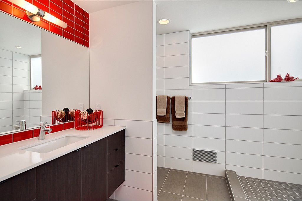 Contemporary Master Bathroom with Corian counters, Standard height, European Cabinets, Flush, Large Ceramic Tile, Casement