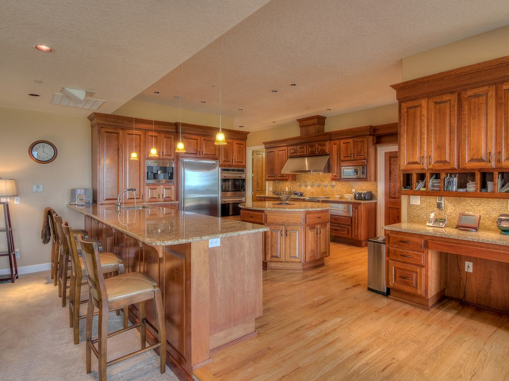 Traditional Kitchen with can lights, Trey ceiling, electric cooktop, built-in microwave, Simple Granite, Carpet, U-shaped