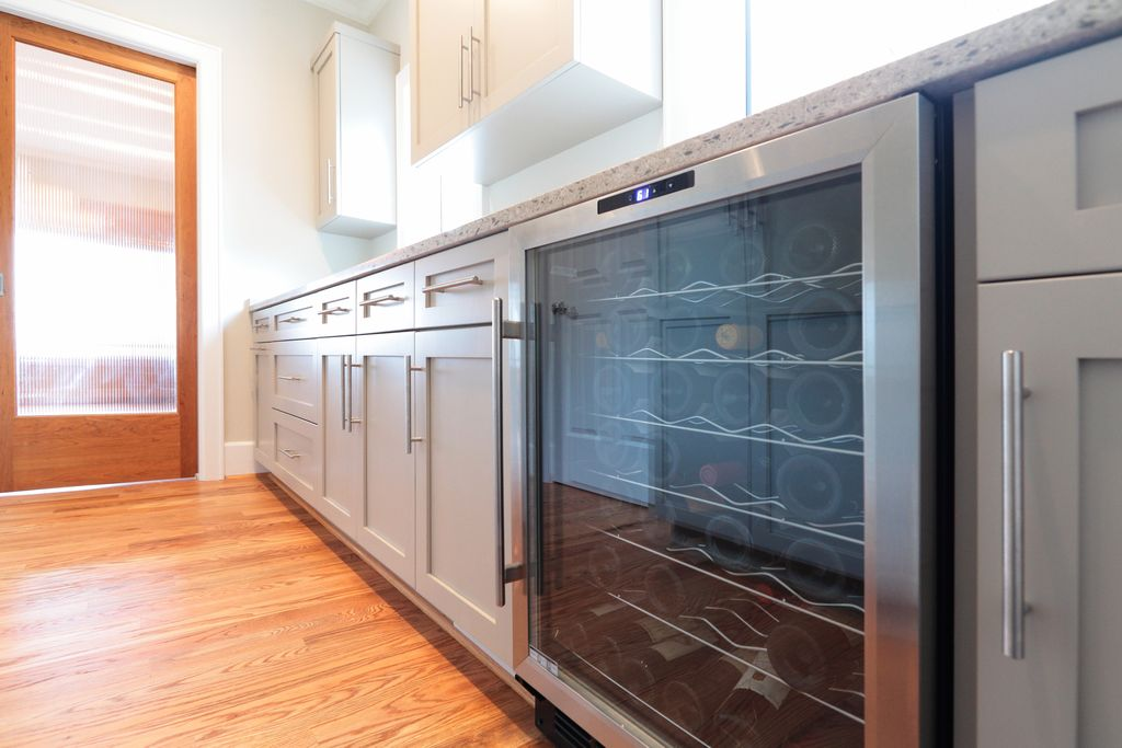 Modern Kitchen with Wine refrigerator, Flush, Paint, Casement, Crown molding, Flat panel cabinets, One-wall, Standard height