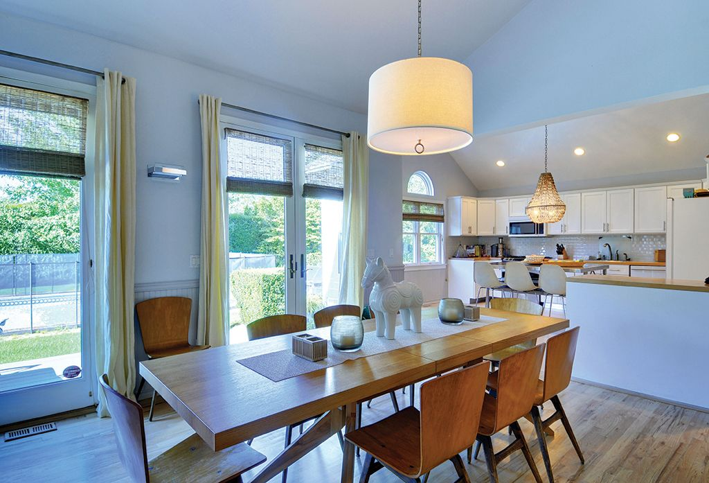 Contemporary Dining Room with double-hung window, Standard height, Hardwood floors, can lights, French doors, Pendant light