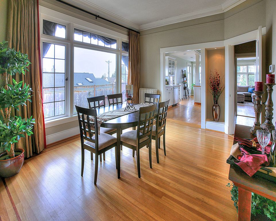 Traditional Dining Room with can lights, Standard height, Hardwood floors, picture window, Crown molding, French doors