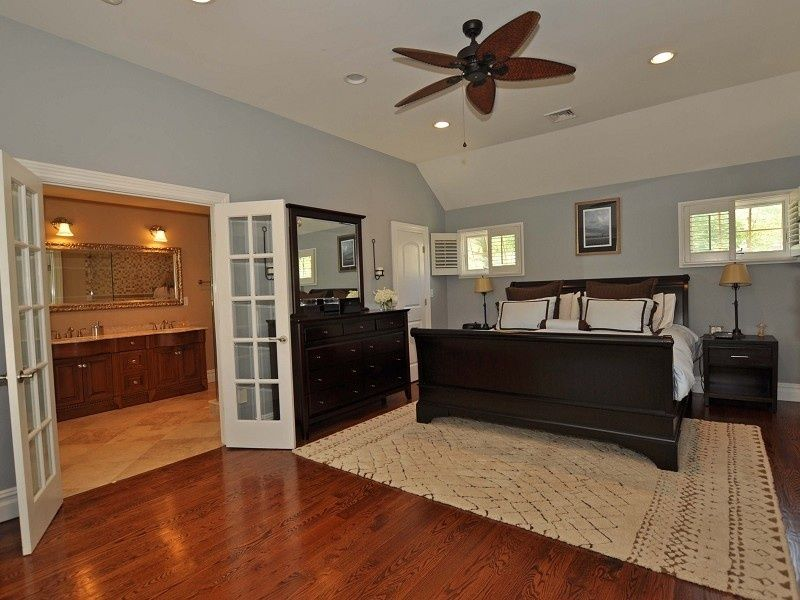 modern master bedroom with french doors ceiling fan letto double