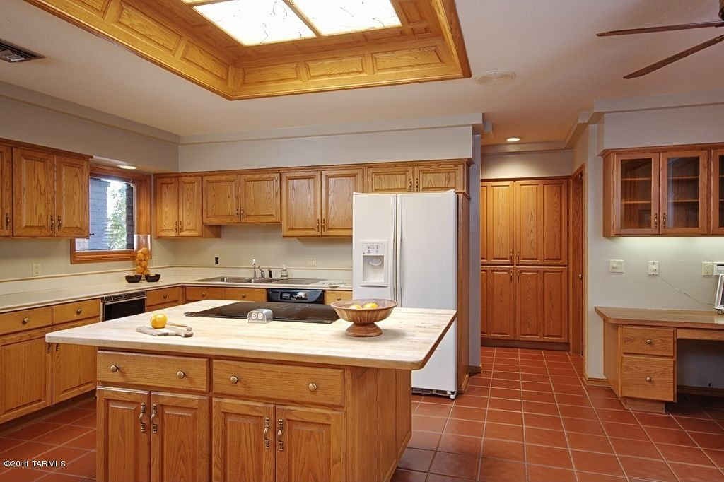 Traditional Kitchen with partial backsplash, Kitchen island, Simple Marble, electric cooktop, Undermount sink, Skylight