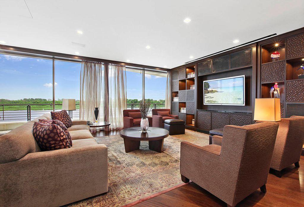 Contemporary Living Room with Built-in bookshelf, Standard height, sliding glass door, picture window, Hardwood floors