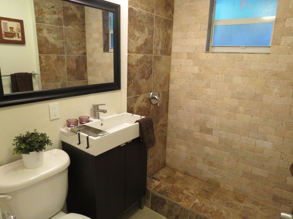 Contemporary 3/4 Bathroom with MS International  Noche Alpaca Travertine Tile, Console sink, double-hung window, Paint 1