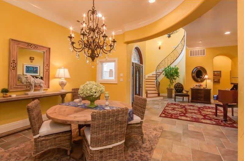 Traditional Dining Room with Casement, Chandelier, Standard height, can lights, Glass panel door, Built-in bookshelf