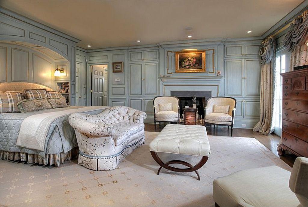 Traditional Master Bedroom with Built-in bookshelf, Crown molding, French doors, Hardwood floors