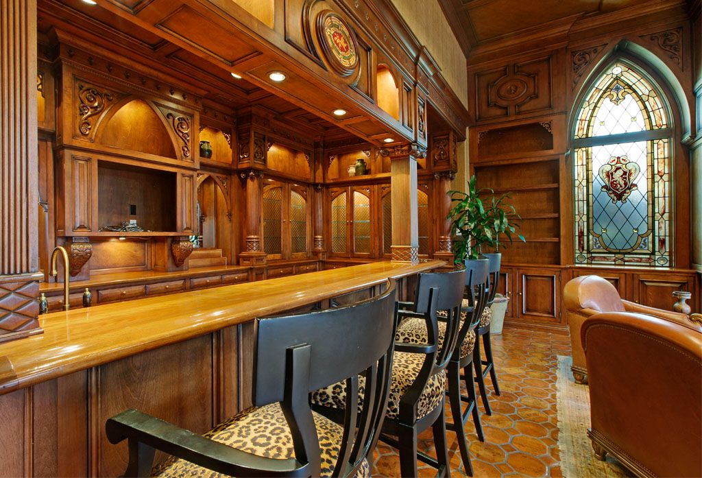 Traditional Bar with terracotta tile floors, can lights, Crown molding, Built-in bookshelf, Stained glass window, Columns