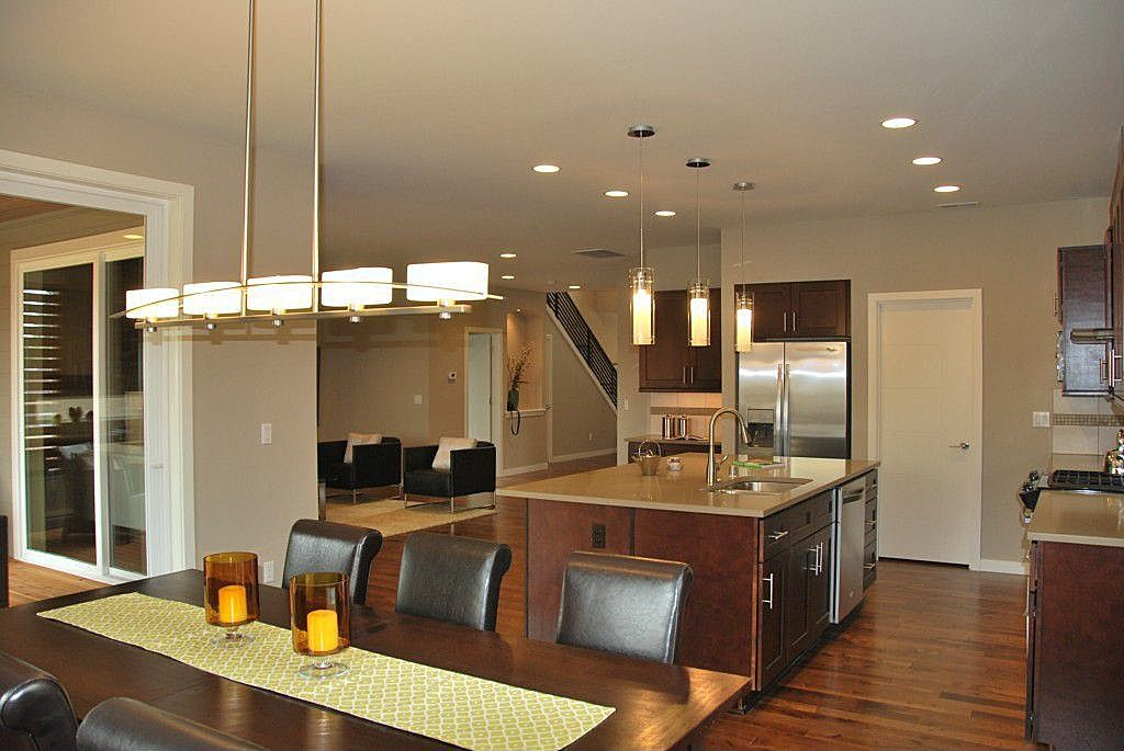 Contemporary Kitchen with gas range, Kitchen island, Soapstone counters, Flush, can lights, Built In Refrigerator, Stone Tile