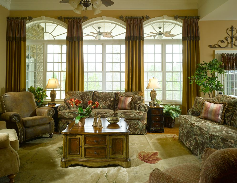 Traditional Living Room with Arched window, Ceiling fan, Crown molding, High ceiling, Hardwood floors