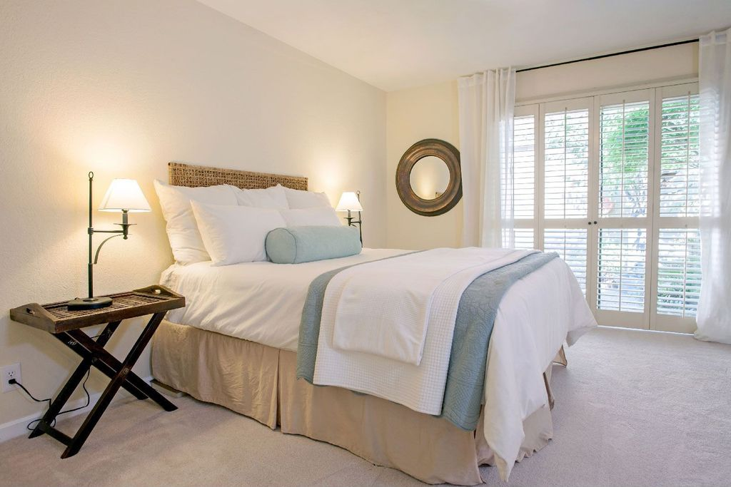 Traditional Guest Bedroom with Pottery Barn - Seagrass Headboard, Plantation shutters, Carpet, French doors