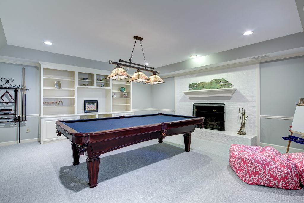 Traditional Basement with High ceiling, Chair rail, Carpet, Spencer marston - catania pool table, brick fireplace, Paint 1
