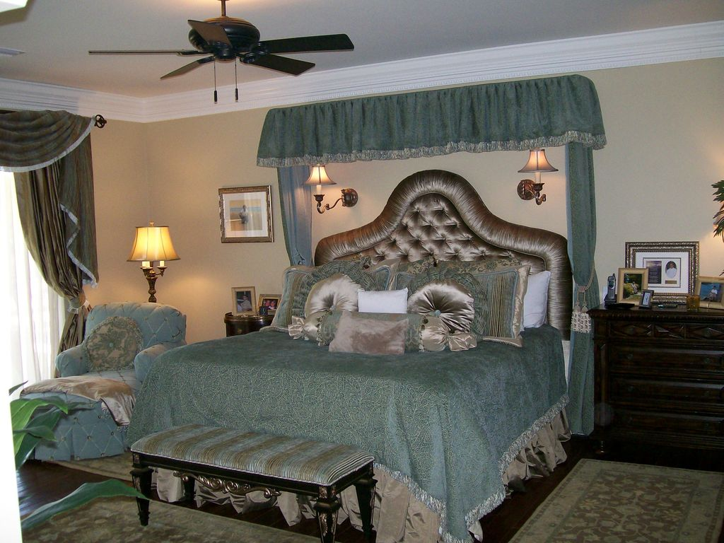 Traditional Master Bedroom with Hardwood floors, bedroom reading light, Standard height, Crown molding, Ceiling fan