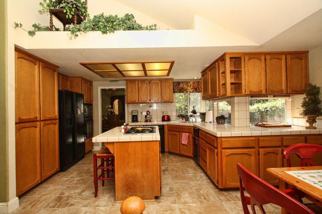 Craftsman Kitchen with European Cabinets, Casement, U-shaped, wall oven, can lights, slate tile floors, full backsplash