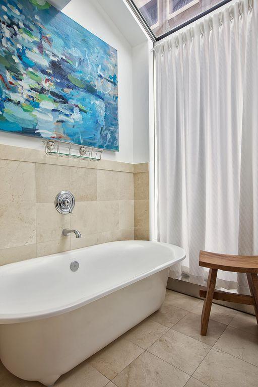 Traditional Master Bathroom with Master bathroom, drop in bathtub, Wall Tiles, Pedestal sink, stone tile floors, Bathtub