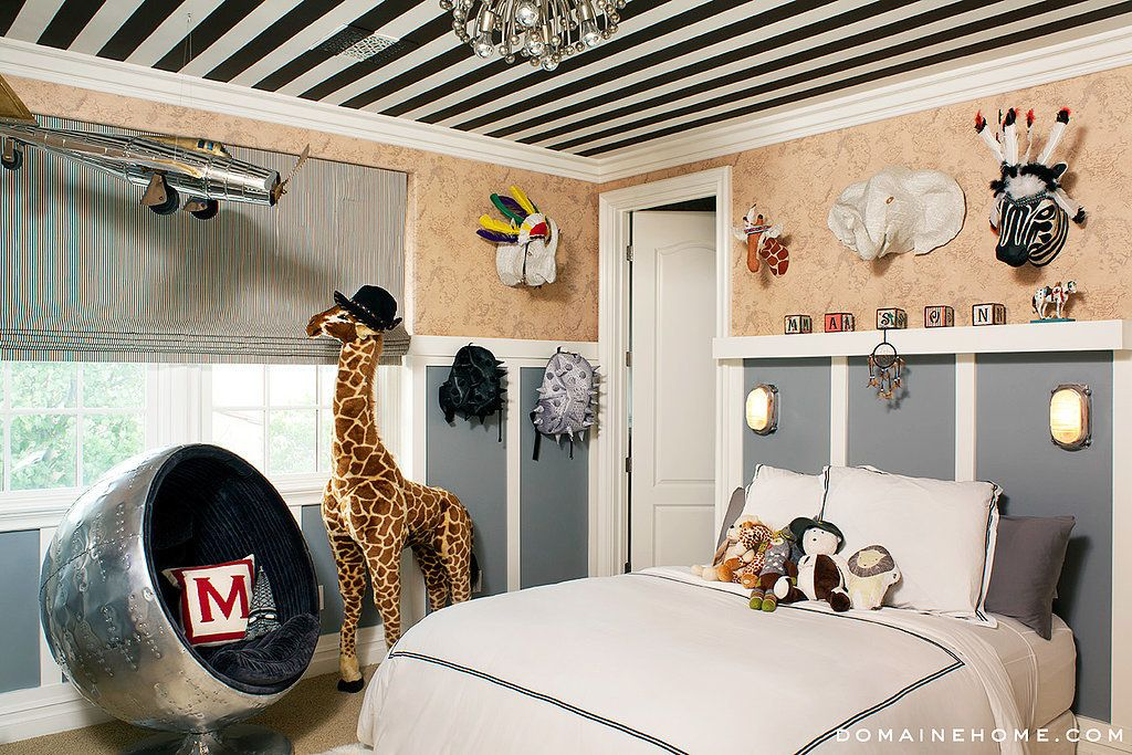 Eclectic Kids Bedroom with Chandelier, Wainscotting, Ford Trimotor Monoplane Scale Model, Wall sconce, Carpet, Ball Chair