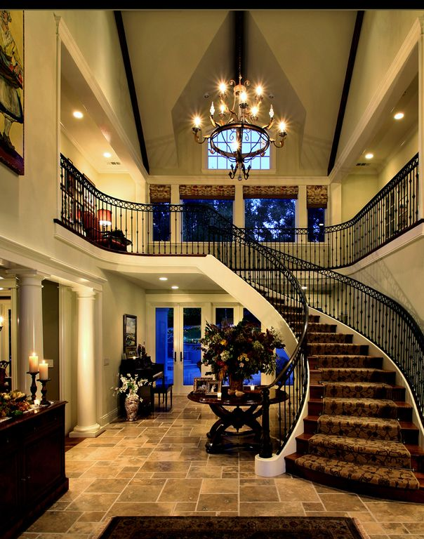 Traditional Staircase with Cathedral ceiling, Loft, Chandelier, slate floors, can lights, curved staircase, Exposed beam