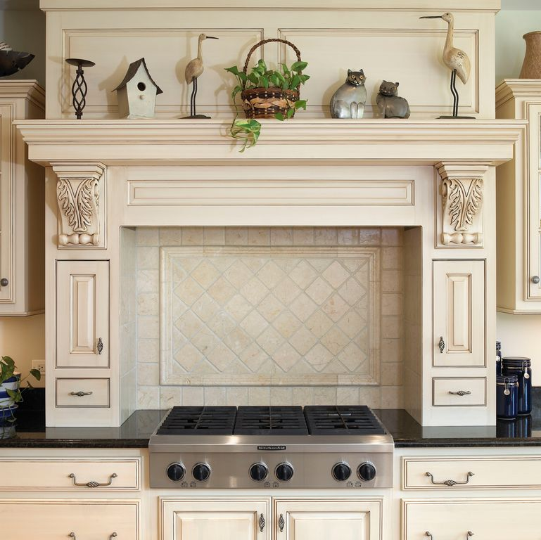 Traditional Kitchen with One-wall, Limestone Tile, Inset cabinets, full backsplash, Framed Partial Panel, electric cooktop