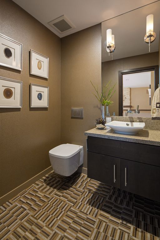 Contemporary Powder Room with Flush, ceramic tile floors, wall-mounted above mirror bathroom light, Standard height