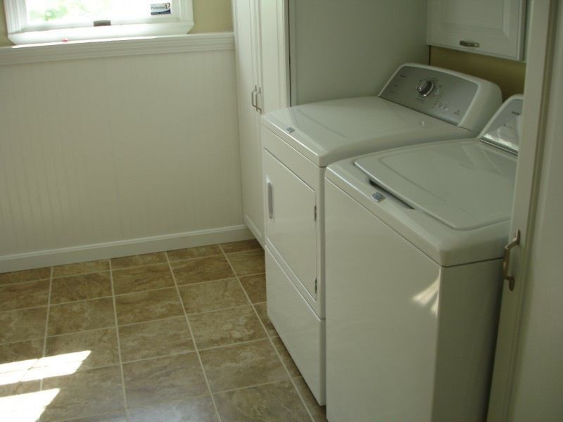 Traditional Laundry Room with Casement, Built-in bookshelf, specialty door, Standard height, Wainscotting, laundry sink