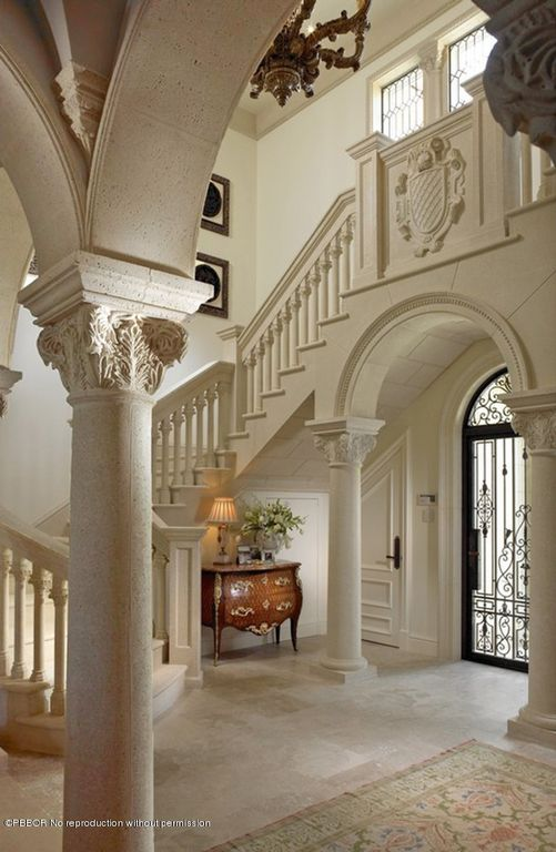 Traditional Entryway with Transom window, French doors, specialty door, Columns, Crown molding, Chandelier, travertine floors