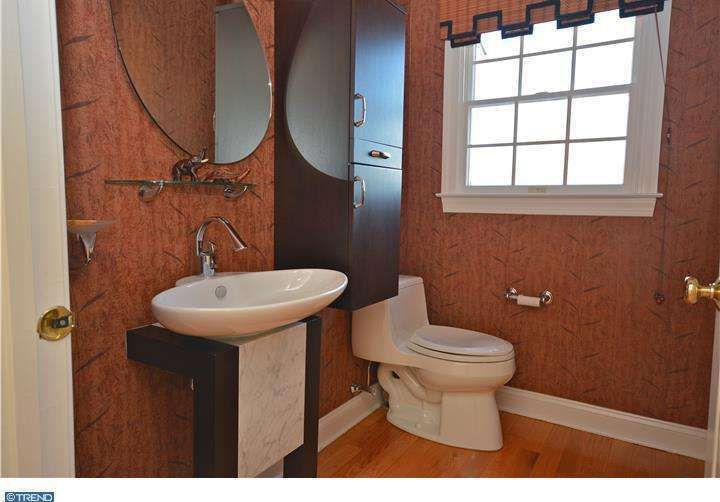 Contemporary Powder Room with Wood counters, European Cabinets, Hardwood floors, interior wallpaper, Vessel sink, Flush