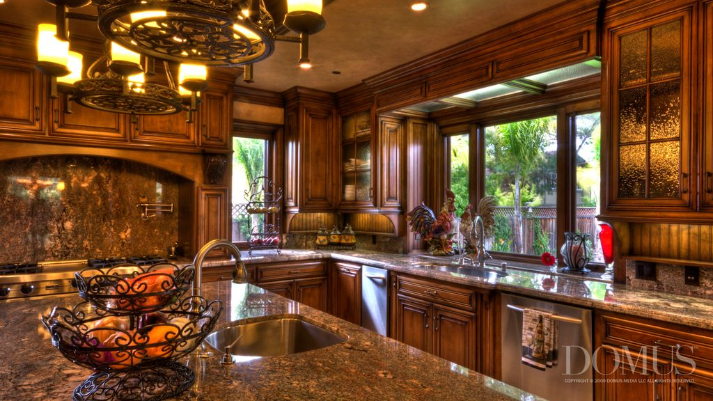 Traditional Kitchen with Complex granite counters, Crown molding, Raised panel, Undermount sink, Standard height, gas range