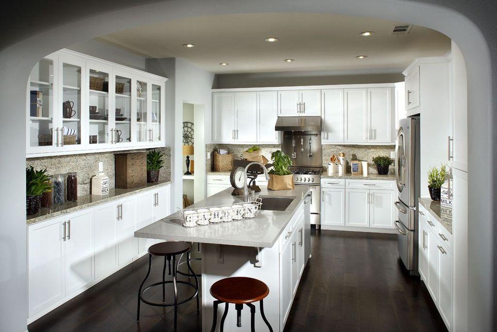 Modern Kitchen with Freestanding Full Size Top Freezer Refrigerator, Anthropologie - monogram mug, Hardwood floors, gas range