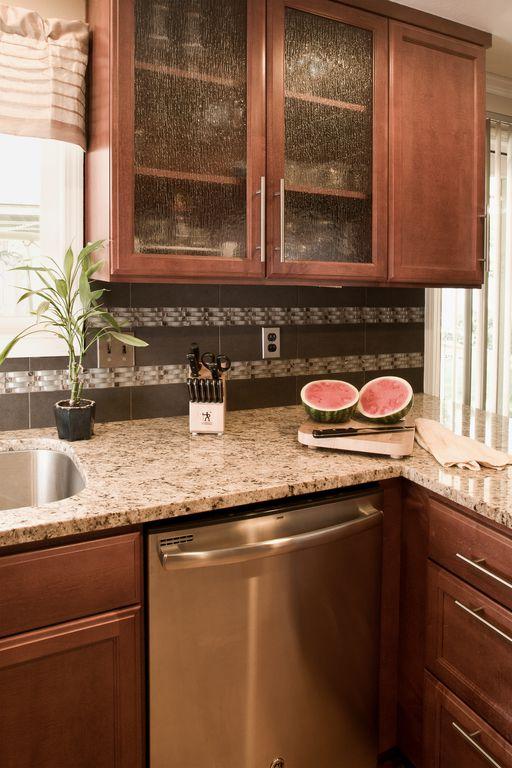 Modern Kitchen with Linnea LLC Pull, L-shaped, Simple granite counters, Ms international blanco tulum granite, Ceramic Tile