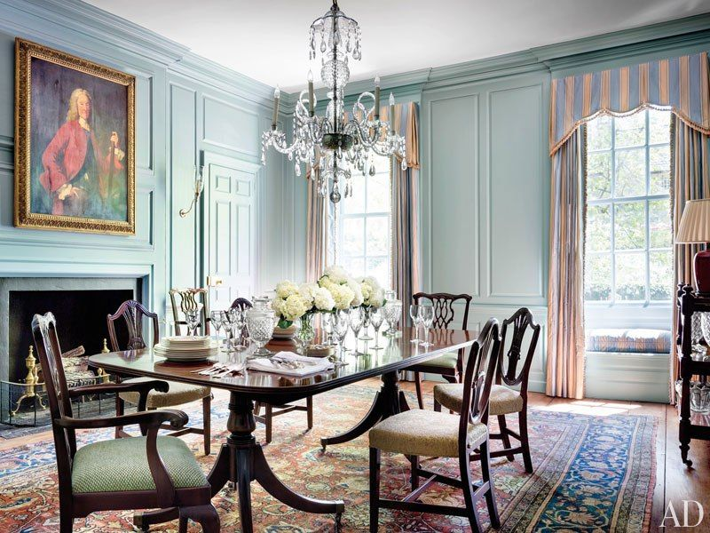 Traditional Dining Room with Fireplace, insert fireplace, six panel door, Casement, Wall sconce, Hardwood floors, Window seat