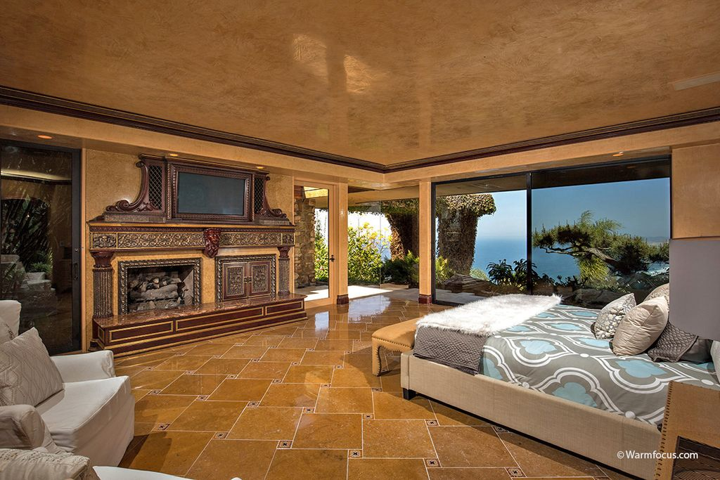 Contemporary master bedroom with stone fireplace for Bedroom marble flooring designs