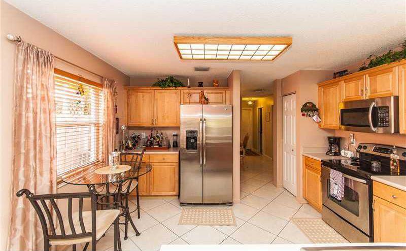 Craftsman Kitchen with Breakfast nook, Limestone, gas range, Casement, partial backsplash, Built In Refrigerator, Flush