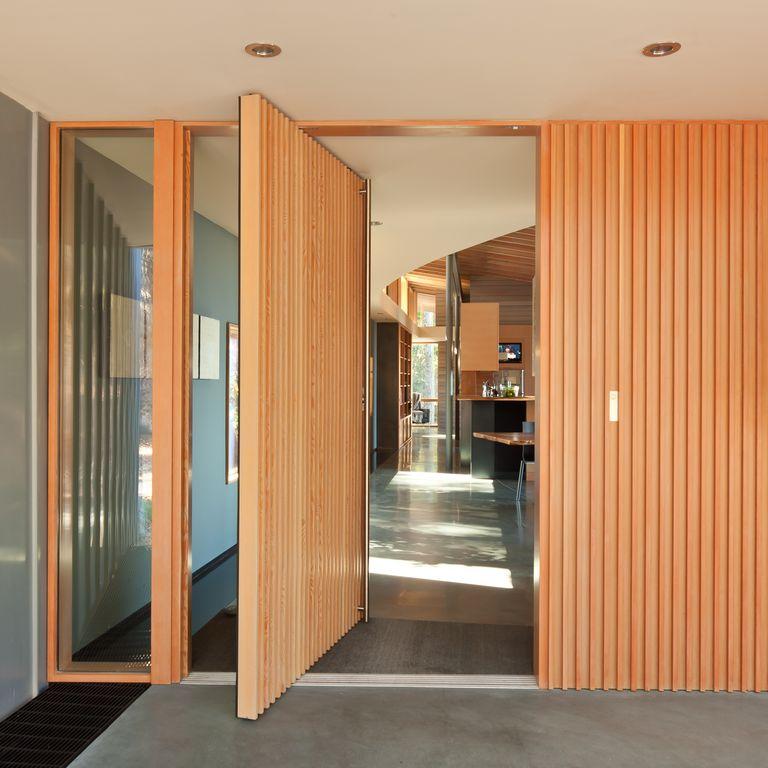 Contemporary Front Door with picture window, Barn door, exterior stone floors