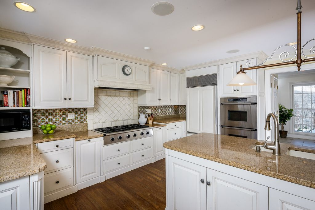 Traditional Kitchen with Dual height countertop, Raised panel, Multiple Sinks, Paint 1, Hardwood floors, double-hung window