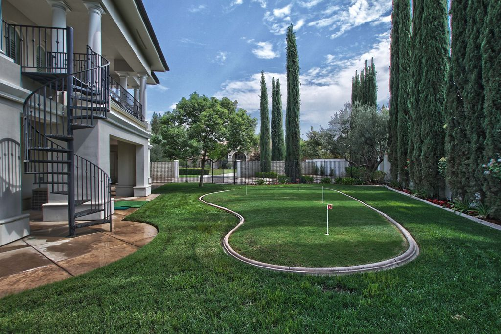 Traditional Landscape/Yard with Fence, Raised beds, Arched window